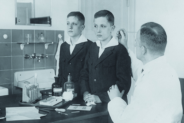 As the head of the Kaiser Wilhelm Institute's Department for Human Heredity, Dr. Otmar von Verschuer, a physician and geneticist, examined hundreds of pairs of twins to study whether criminality, feeble-mindedness, tuberculosis, and cancer were inheritable. Archiv zur Geschichte der Max-Planck-Gesellschaft, Berlin Dahlem