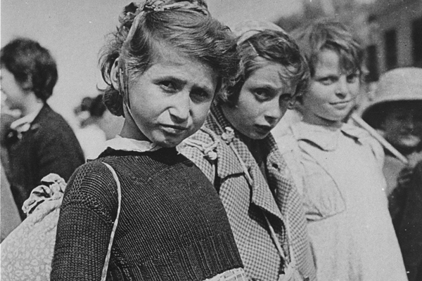 Three Jewish refugee girls wait prior to their departure from Iran as part of the Tehran children's transport. US Holocaust Memorial Museum, courtesy of David Laor