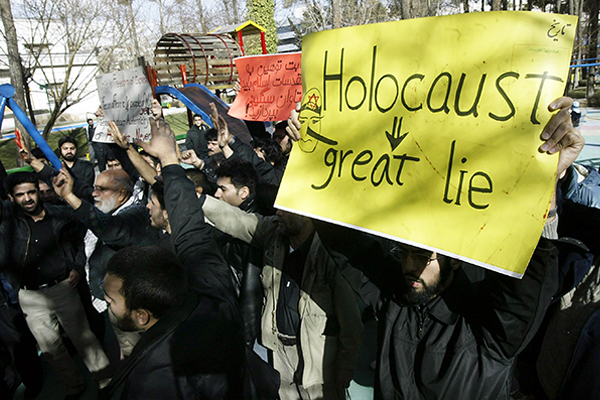 This sign is from a protest in Iran in 2006 by hardline Islamists protesting a Danish newspaper cartoon they perceived as an insult to the Prophet Mohammed. It is part of a pattern of denial, distortion, and other antisemitic activity around the world. Mohammad Kheirkhah/UPI/Newscom