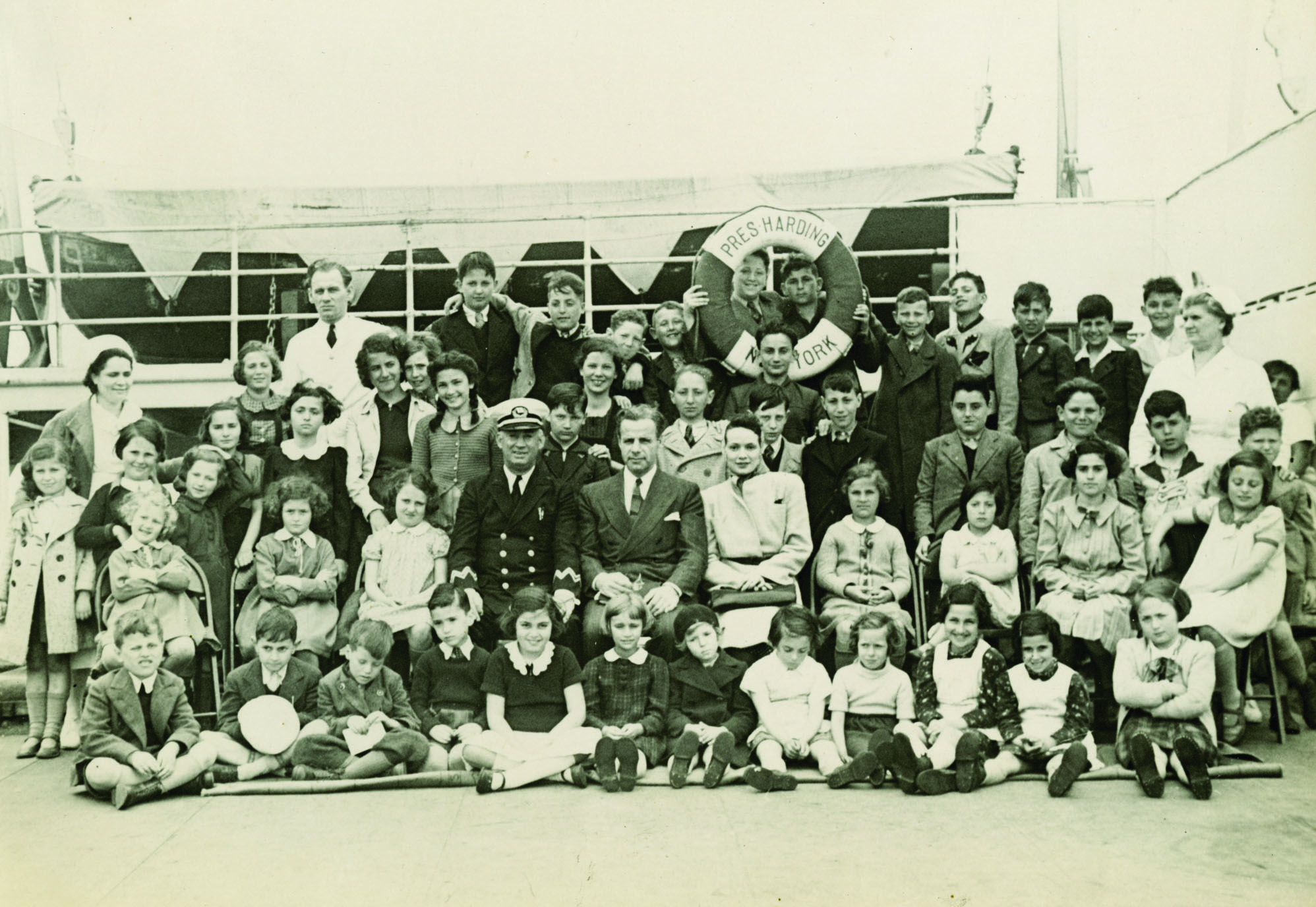 Gilbert and Eleanor Kraus pose with the rescued children on the SS President Harding, 1939. Courtesy of PerlePress Productions