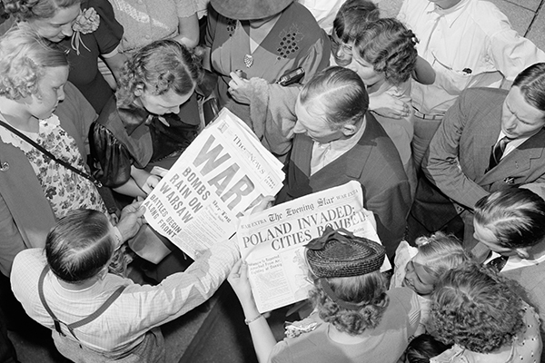 A crowd in Washington, DC, looks at newspapers on September 1, 1939. Library of Congress