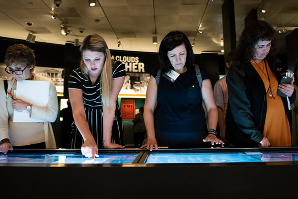 Museum visitors explore an interactive display in the Americans and the Holocaust special exhibition. US Holocaust Memorial Museum