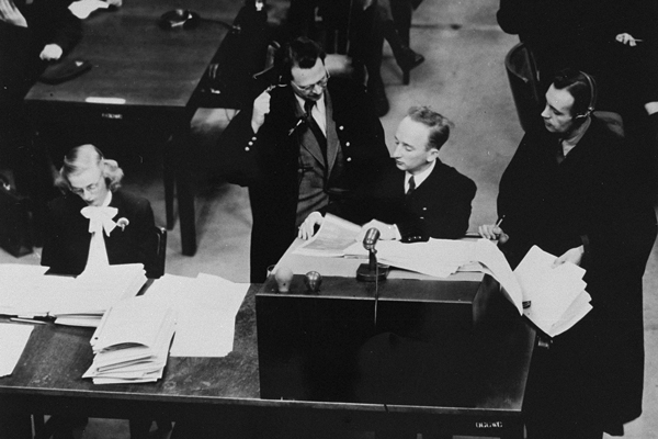Chief prosecutor Benjamin Ferencz presents documents as evidence at the Einsatzgruppen Case. US Holocaust Memorial Museum, courtesy of Benjamin Ferencz
