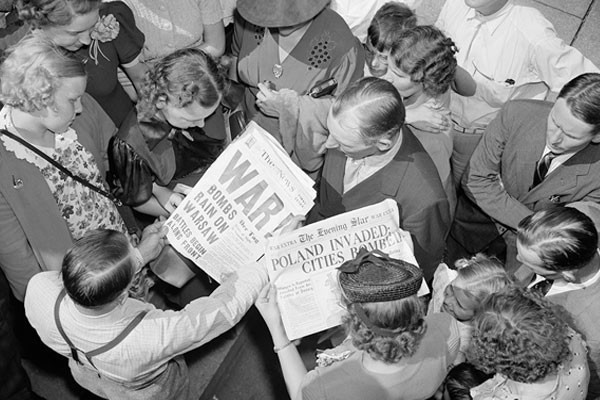 People look at Washington, DC, newspapers on September 1, 1939—the day Nazi Germany invaded Poland, starting World War II. Harris & Ewing Collection/Library of Congress