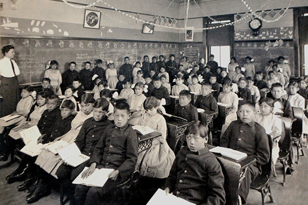 Students at the Genoa Indian School in 1910. The school educated Indian children forcibly taken from their family and tribes. Public Domain