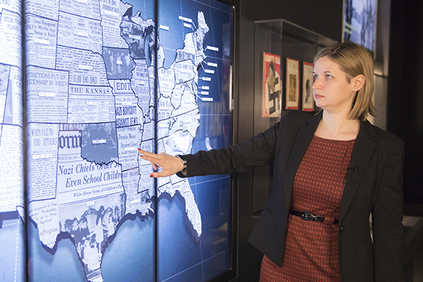 Dr. Rebecca Erbelding demonstrates an interactive feature in Americans and the Holocaust. US Holocaust Memorial Museum