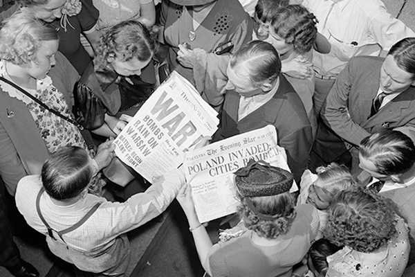 A crowd looks at Washington, DC, newspapers on September 1, 1939. Library of Congress