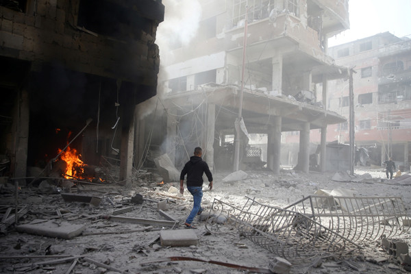 A man walks on rubble at a damaged site after an air strike on February 9, 2018, in the besieged town of Douma in the Eastern Ghouta area of Damascus, Syria. Bassam Khabieh/Reuters