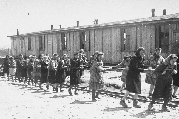 Jewish women forced to labor at the Płaszów concentration camp in German-occupied Poland. US Holocaust Memorial Museum, courtesy of Leopold Page Photographic Collection