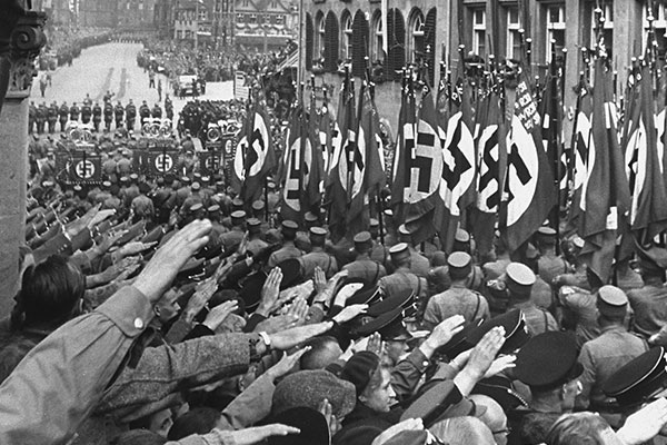 Spectators cheer passing SA formations during a Reichsparteitag (Reich Party Day) parade, 1937. US Holocaust Memorial Museum, courtesy of bpk-Bildagentur