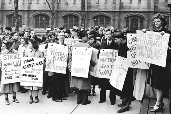 Student members of the University of Chicago Youth Committee against the War are shown with signs in May 1939. University of Chicago Photographic Archive, apf3-03030, Special Collections Research Center, University of Chicago Library