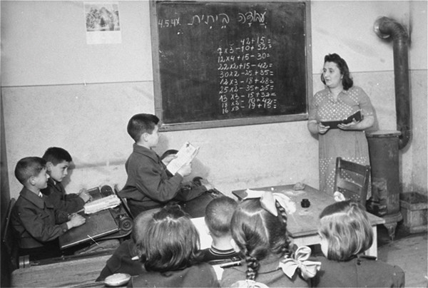 Students study math at the Zeilsheim displaced persons camp in Germany after World War II. US Holocaust Memorial Museum, courtesy of Alice Lev