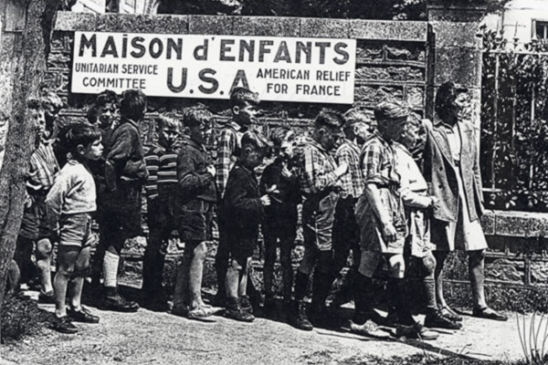 French children wait in line for assistance from the Unitarian Service Committee in France, circa 1939–1941. Unitarian Universalist Service Committee