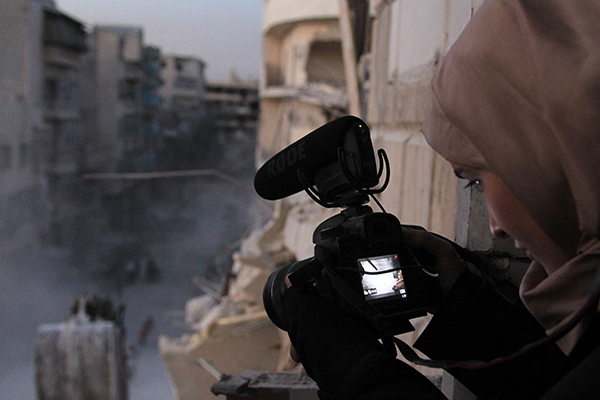 Waad al-Kateab films the ruins of a building destroyed by bombing in besieged east Aleppo. Courtesy of PBS Distribution