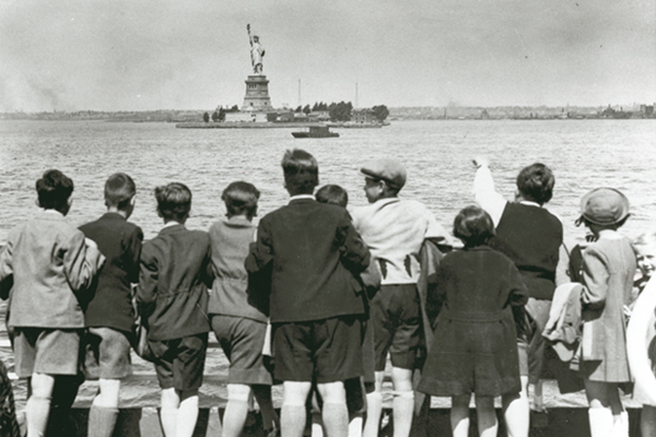 Children aboard the President Harding pull into New York harbor in 1939. They were brought to the United States by Gilbert and Eleanor Kraus with the help of American diplomat, Raymond Geist, who secured visas for hundreds of unaccompanied children. US Holocaust Memorial Museum, courtesy of Steven Pressman