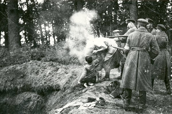 German officials and Ukrainian militia shooting a Jewish family, Miropol, Ukraine, October 13, 1941. Security Services Archive, Historical Collection of the State Security Service (StB) Prague, archival no. H-770-3