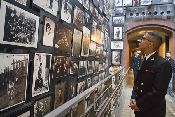A Naval Academy student tours the Museum's main exhibition as part of the Joint Service Academies Mass Atrocity Prevention Symposium. US Holocaust Memorial Museum