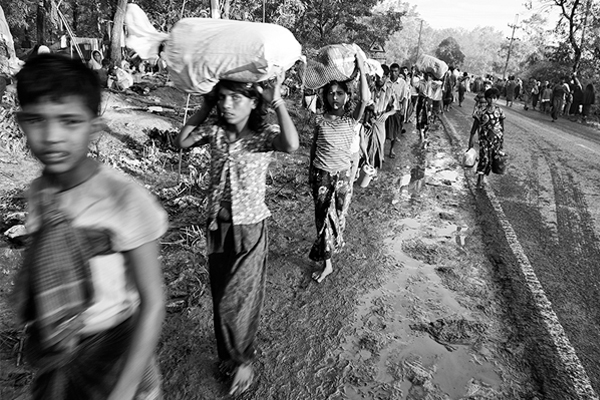 Hundreds of thousands of Rohingya have flooded into southern Bangladesh. The north-south highway between Cox's Bazar and Teknaf was a steady flow of Rohingya refugees in September 2017. Greg Constantine for the US Holocaust Memorial Museum